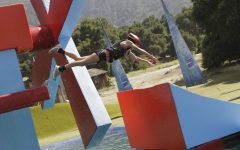 Photo taken by Mike Weaver of a contestant performing a jump on Wipeout, 2011