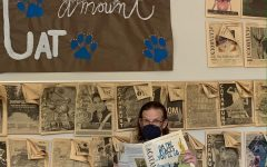 Mr. Crouch in the Catamount newsroom, surrounded by past issues and wonderful memories. Photo by Cyrus Comstock (24)